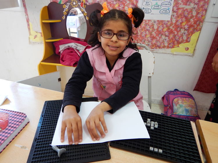Visually impaired girl using Braille in Tunisia
